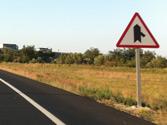 A la vista de esta señal, ¿debe facilitar la incorporación de los vehículos que se incorporen por la derecha? 1