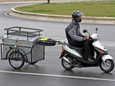 Las motocicletas, ciclomotores o vehículos de tres ruedas, ¿pueden arrastrar un remolque o semirremolque? 1