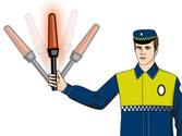 Un agente se dirige hacia su vehículo balanceando una luz roja. ¿Qué debe hacer? 1